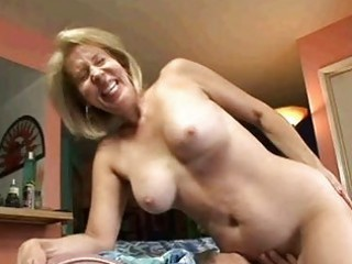 blond granny sucks on cock then gets her old