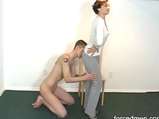 Naked slave licks mistress legs for worship
