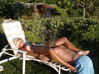 older blonde lifeguard gets her big tits licked
