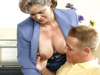 Busty mom gets fucked in the office