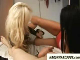 Two hot milf babes give a rough handjob and slap