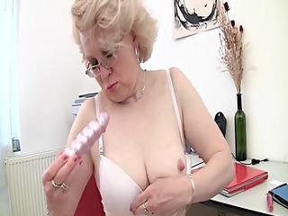 blond older and her sex toy (masturbation)