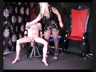 Chubby blonde mistress gives her hooded slave a