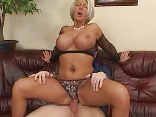 breasty aged blond in darksome fishnet brassiere