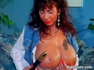 pretty mega boobed older slut uses part0