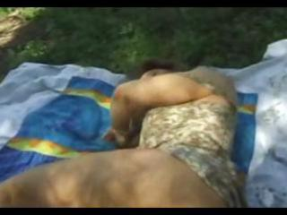 Brunette wife is taking a nap outdoors gets woken