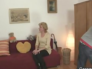 youthful guy picks up old golden-haired and