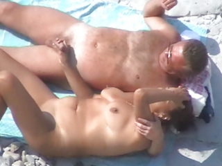 some other worthy mature couple on the beach