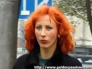 older redhead taking a void urine in a public park