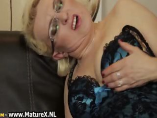 horny mature is rubbing her bawdy cleft
