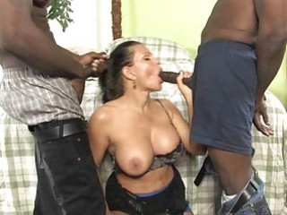 Busty milf gets ravaged by two dicks in front of
