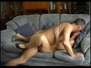 husband and wife have a quick fuck on the sofa !
