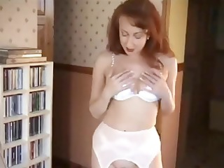 redhead in underware is posing and rubbing her
