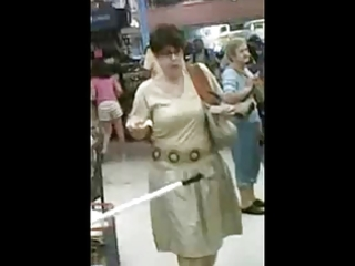 older woman at the grocery store