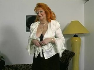 Red-headed German granny shows off for the camera