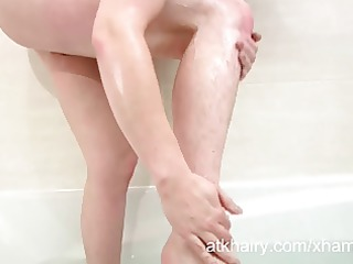 hirsute jenna gets her pussy moist and masturbates