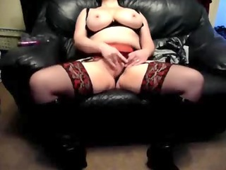 lascivious wife on a leather daybed at home