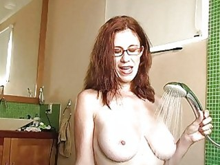 wicked redhead milf with glasses gets cum on her