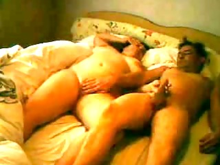 Mature couple playing in hotel room