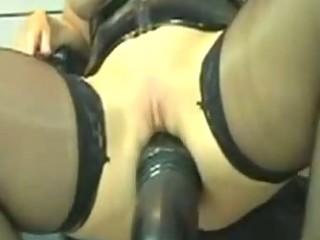 kinky leather milf marian rides huge fake penis