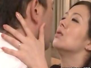 mature asian milf giving a kiss with voyeur