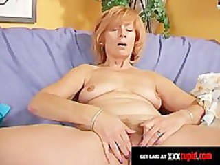 redheaded granny uses a vibrator