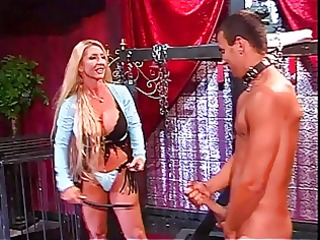 Busty blond dominatrix plays rough with sex slave