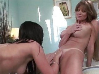 Heavy chested lesbian momma licking honey pot to