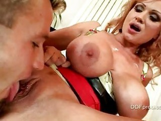 Mature whore with enormous tits gets her pierced