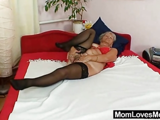 unsightly grandma cecilie toys her curly pussy