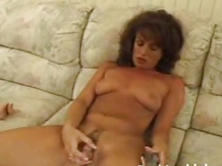 mature babe toying shaggy pussy