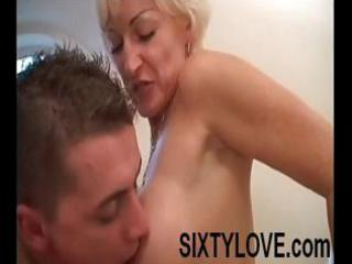 older golden-haired mom is in the tub with a
