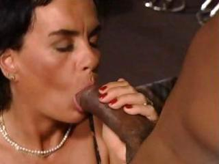 Brunette german milf eats a black cock and gets