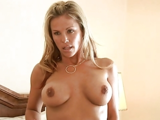 Blonde milf massages her huge breast with a lotion