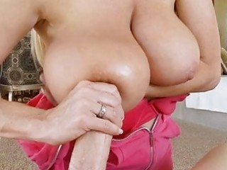 Teasing blonde milf with massive tits does