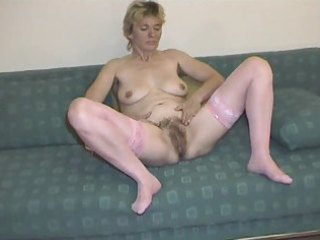 curly aged in pink nylons disrobes