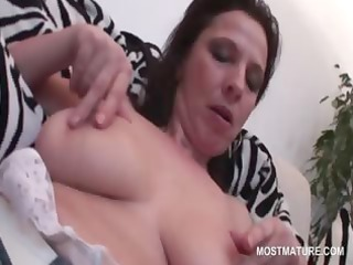 Naked mature shoving panties deep inside her pussy