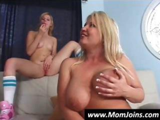 mother and daughter take turns blowing this guy