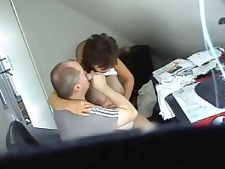 Horny brunette secretary gets caught on spy cam