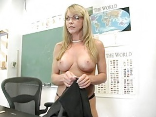 golden-haired older teacher shows off her stylish
