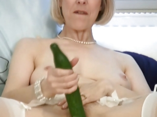 aged housewife fucks a cucumber