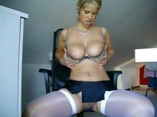 busty milf disrobes on a chair to show her melons
