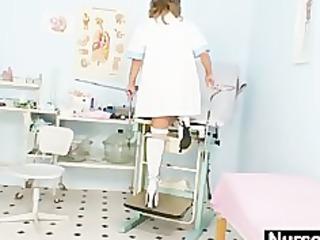 slim milf senior nurse toys her slit on gynochair