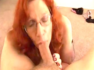 aged redhead receives a spunk flow on her large