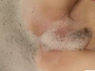 redhead mamma pleasures her soapy twat