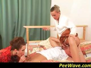 Two hot milfs are having a good pissing time in a