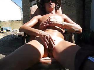 english aged films herself wanking in backyard