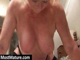 bulky blond granny squeezes her large titis and
