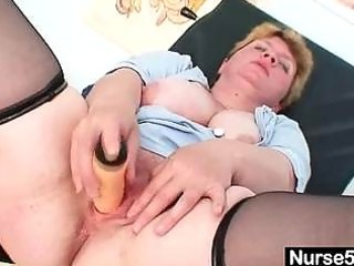 unpretty chubby mature toys herself with gyno
