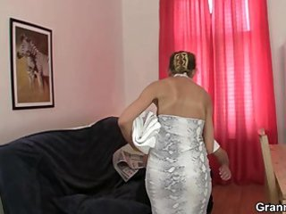 older masseuse sucks and rides young meat